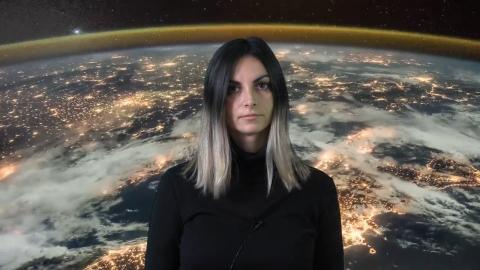Valentina Karga with planetary background