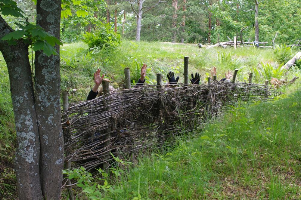 Martial Law at Patterimäki park hands up behind a fence