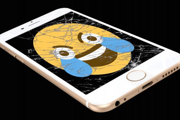 Smiley with tears on broken smart phone screen