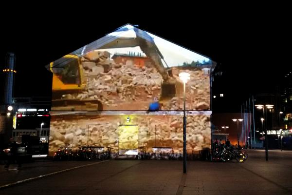 Night Searchers bus station facade projection by Maija Saksman