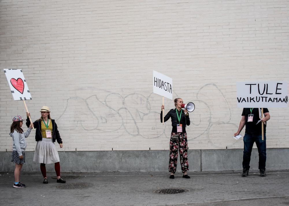 Actors on the street demonstrating with signs.