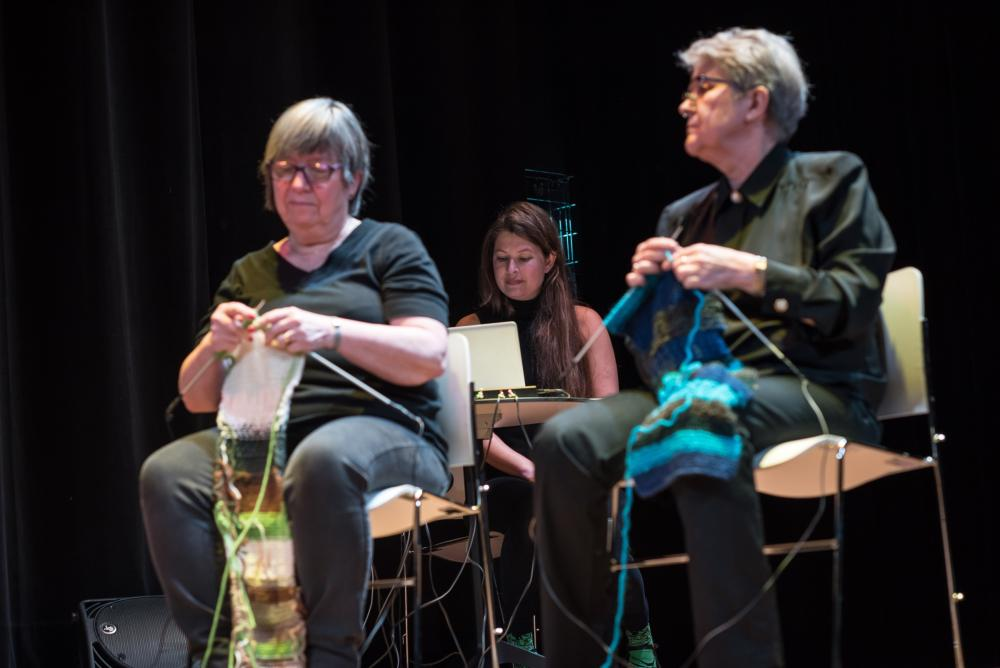 Sounds and Stories Live Performance, Jobina Tinnemans and two knitters on stage